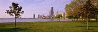 """Trees in a park with lake and buildings in the background, Lincoln Park, Lake Michigan, Chicago, Illinois, USA by Panoramic Images - 36"""" x 12"""""""