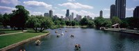 """High angle view of a group of people on a paddle boat in a lake, Lincoln Park, Chicago, Illinois, USA by Panoramic Images - 36"""" x 12"""", FulcrumGallery.com brand"""