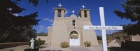 """Cross in front of a church, San Francisco de Asis Church, Ranchos De Taos, New Mexico, USA by Panoramic Images - 36"""" x 12"""", FulcrumGallery.com brand"""