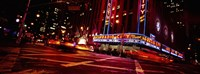 "Low angle view of buildings at night, Radio City Music Hall, Rockefeller Center, Manhattan, New York City, New York State, USA by Panoramic Images - 36"" x 12"""