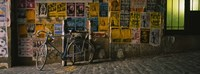 """Bicycle leaning against a wall with posters in an alley, Post Alley, Seattle, Washington State, USA by Panoramic Images - 36"""" x 12"""", FulcrumGallery.com brand"""