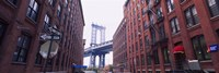 "Low angle view of a suspension bridge viewed through buildings, Manhattan Bridge, Brooklyn, New York City, New York State, USA by Panoramic Images - 36"" x 12"""