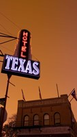 "Low angle view of a neon sign of a hotel lit up at dusk, Fort Worth Stockyards, Fort Worth, Texas, USA by Panoramic Images - 21"" x 36"""