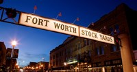 "Signboard over a road at dusk, Fort Worth Stockyards, Fort Worth, Texas, USA by Panoramic Images - 36"" x 19"""