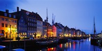 """Buildings lit up at night, Nyhavn, Copenhagen, Denmark by Panoramic Images - 27"""" x 14"""""""