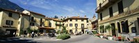 """Tourists Sitting At An Outdoor Cafe, Menaggio, Italy by Panoramic Images - 27"""" x 9"""""""