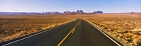 "Road passing through a desert, Monument Valley, Arizona, USA by Panoramic Images - 27"" x 9"""