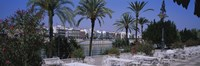 """Sidewalk cafe at the riverside, Guadalquivir River, Seville, Spain by Panoramic Images - 27"""" x 9"""""""