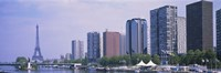 """Skyscrapers at the waterfront with a tower in the background, Seine River, Eiffel Tower, Paris, Ile-De-France, France by Panoramic Images - 27"""" x 9"""""""