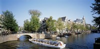 """Netherlands, Amsterdam, tour boat in channel by Panoramic Images - 27"""" x 9"""", FulcrumGallery.com brand"""