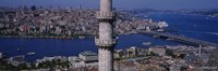 Mid section view of a minaret with bridge across the bosphorus in the background, Istanbul, Turkey Fine Art Print