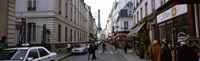 """Buildings along a street with a tower in the background, Rue Saint Dominique, Eiffel Tower, Paris, Ile-de-France, France by Panoramic Images - 27"""" x 9"""""""