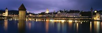 """Buildings lit up at dusk, Chapel Bridge, Reuss River, Lucerne, Switzerland by Panoramic Images - 27"""" x 9"""", FulcrumGallery.com brand"""