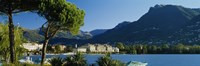 "City on the waterfront, Lake Lugano, Lugano, Switzerland by Panoramic Images - 27"" x 9"""