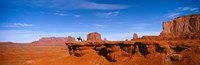 Person riding a horse on a landscape, Monument Valley, Arizona, USA Fine Art Print