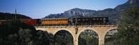 "Train crossing a bridge, Sierra De Tramuntana, Majorca, Spain by Panoramic Images - 27"" x 9"" - $28.99"