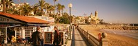 """Tourists in a cafe, Tapas Cafe, Sitges Beach, Catalonia, Spain by Panoramic Images - 27"""" x 9"""", FulcrumGallery.com brand"""