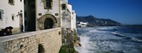"""Tourists in a church beside the sea, Sitges, Spain by Panoramic Images - 27"""" x 9"""", FulcrumGallery.com brand"""