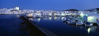 """Buildings lit up at night, Paros, Cyclades Islands, Greece by Panoramic Images - 27"""" x 9"""""""