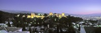 """High angle view of a castle lit up at dusk, Alhambra, Granada, Andalusia, Spain by Panoramic Images - 27"""" x 9"""""""