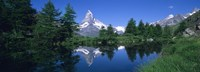 Reflection of a snow covered mountain near a lake, Grindjisee, Matterhorn, Zermatt, Switzerland Fine Art Print