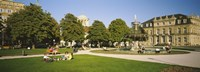 """Group Of People Sitting Around A Fountain In A Park, Schlossplatz, Stuttgart, Baden-Wurttemberg, Germany by Panoramic Images - 27"""" x 9"""""""