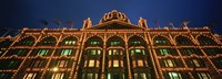 """Low angle view of a building lit up at night, Harrods, London, England by Panoramic Images - 27"""" x 9"""""""