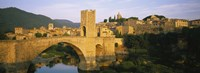 "Arch bridge across a river in front of a city, Besalu, Catalonia, Spain by Panoramic Images - 27"" x 9"""