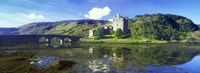 "Reflection of a castle and a mountain in water, Eilean Donan Castle, Loch Duich, Scotland by Panoramic Images - 27"" x 9"""