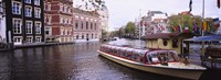 Tourboat in a channel, Amsterdam, Netherlands Fine Art Print