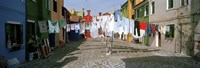"""Clothesline in a street, Burano, Veneto, Italy by Panoramic Images - 27"""" x 9"""""""