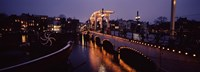"Bridge lit up at night, Magere Brug, Amsterdam, Netherlands by Panoramic Images - 27"" x 9"""