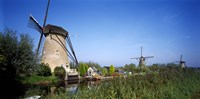 """Traditional windmills in a field, Netherlands by Panoramic Images - 27"""" x 9"""" - $28.99"""