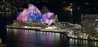 """Opera house lit up at night, Sydney Opera House, Sydney, New South Wales, Australia by Panoramic Images - 27"""" x 9"""""""