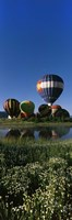 "Reflection of hot air balloons in a lake, Hot Air Balloon Rodeo, Steamboat Springs, Colorado, USA by Panoramic Images - 9"" x 27"""