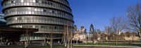 "Buildings in a city, Sir Norman Foster Building, London, England by Panoramic Images - 27"" x 9"""