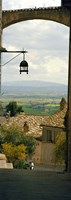 """Umbrian countryside viewed through an alleyway, Assisi, Perugia Province, Umbria, Italy by Panoramic Images - 9"""" x 27"""""""