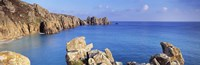 """Rock formations at seaside, Logan rock, Porthcurno Bay, Cornwall, England by Panoramic Images - 27"""" x 9"""""""
