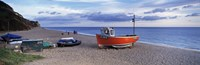 "Boats on the beach, Branscombe Beach, Devon, England by Panoramic Images - 27"" x 9"""