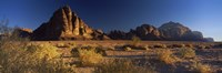 """Rock formations on a landscape, Seven Pillars of Wisdom, Wadi Rum, Jordan by Panoramic Images - 27"""" x 9"""""""