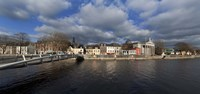 """The Millenium Foot Bridge Over the River Lee,St Annes Church Behind, And St Mary's Church (right),Cork City, Ireland by Panoramic Images - 27"""" x 9"""""""