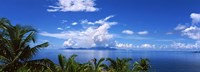 Indian ocean with palm trees towards Mahe Island looking from North Island, Seychelles Fine Art Print