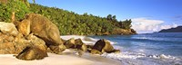 """Rocks on a small beach on North Island, Seychelles by Panoramic Images - 27"""" x 9"""""""