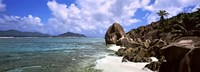 """Rock formations on the beach on Anse Source d'Argent beach with Praslin Island in the background, La Digue Island, Seychelles by Panoramic Images - 27"""" x 9"""""""