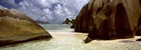 """Crystal clear waters and large granite rocks on Anse Source d'Argent beach, La Digue Island, Seychelles by Panoramic Images - 27"""" x 9"""""""