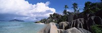 """Anse source d'Argent beach with Praslin Island in background, La Digue Island, Seychelles by Panoramic Images - 27"""" x 9"""""""