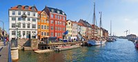 """Buildings along a canal with boats, Nyhavn, Copenhagen, Denmark by Panoramic Images - 27"""" x 9"""", FulcrumGallery.com brand"""