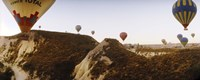 "Hot air balloons soaring over a mountain ridge, Cappadocia, Central Anatolia Region, Turkey by Panoramic Images - 27"" x 9"""