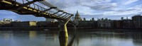 """Bridge across a river with a cathedral, London Millennium Footbridge, St. Paul's Cathedral, Thames River, London, England by Panoramic Images - 27"""" x 9"""""""