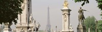 """Low angle view of a statue, Alexandre III Bridge, Eiffel Tower, Paris, France by Panoramic Images - 36"""" x 12"""""""